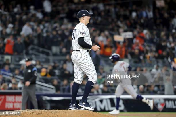 Chad Green of the New York Yankees reacts after allowing a threerun home run to Carlos Correa of the Houston Astros during the sixth inning in game...