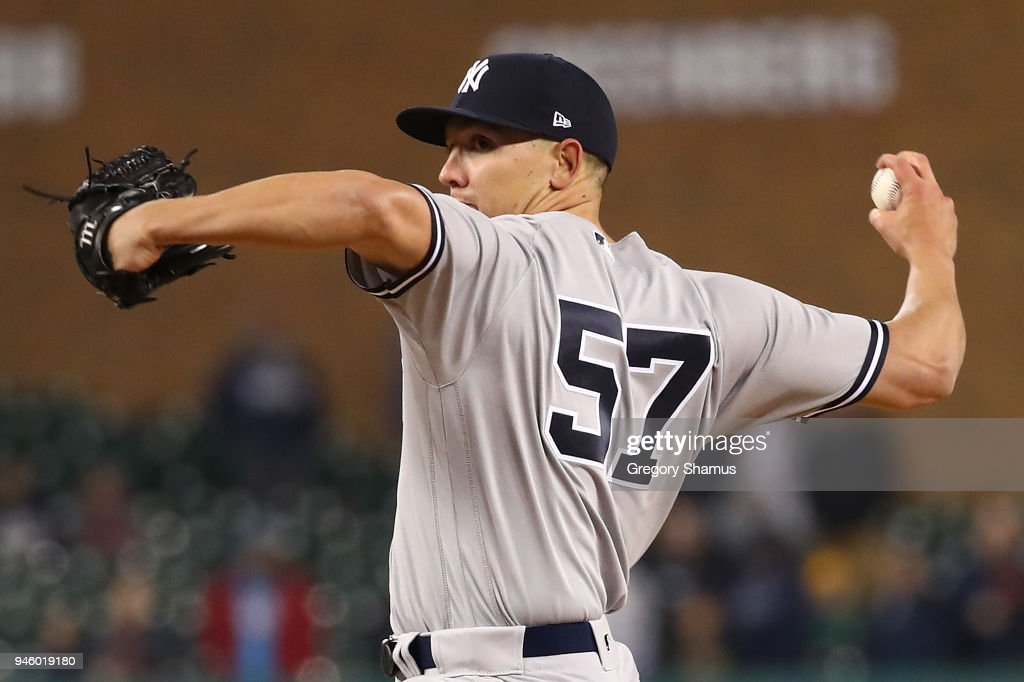 Chad Green #57 of the New York Yankees throws a eighth inning pitch while playing the Detroit Tigers at Comerica Park on April 13, 2018 in Detroit, Michigan. New York won the game 8-6.