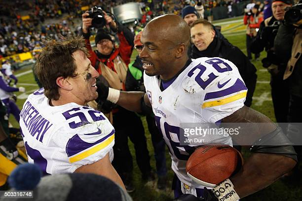 Chad Greenway of the Minnesota Vikings and Adrian Peterson react after their game against the Green Bay Packers at Lambeau Field on January 3 2016 in...