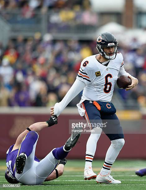 Chad Greenway of the Minnesota Vikings pulls down quarterback Jay Cutler of the Chicago Bears for a sack during the first quarter of the game on...