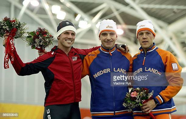 Chad Hedrick of the United States Bob de Jong of the Netherlands and Carl Verheijen of the Netherlands celebrate during the flower ceremony after the...