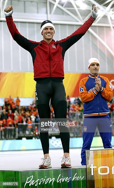 Chad Hedrick of the United States celebrates winning the Silver medal during the flower ceremony of the 10000 meter men's speed skating final during...