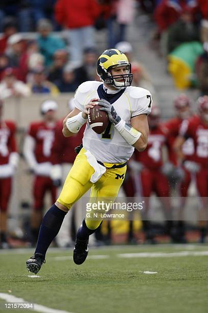 Chad Henne of Michigan rolls out to pass during action between the Michigan Wolverines and Indiana Hoosiers at Memorial Stadium in Bloomington...