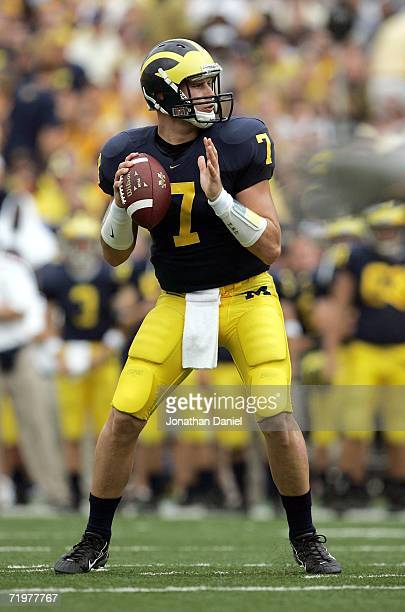 Chad Henne of the Michigan Wolverines looks for a receiver against the Wisconsin Badgers on September 23 2006 at Michigan Stadium in Ann Arbor...