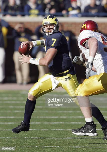 Chad Henne of the Michigan Wolverines looks to pass during the game against the Minnesota Gophers at Michigan Stadium on October 8 2005 in Ann Arbor...