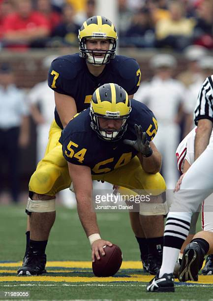 Chad Henne of the Michigan Wolverines prepares to take a snap from Mark Bihl during the game with the Wisconsin Badgers on September 23 2006 at...