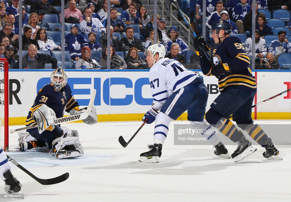 Chad Johnson #31 and Rasmus Ristolainen #55 of the Buffalo Sabres defend against Leo Komarov #47 of the Toronto Maple Leafs during an NHL game on March 5, 2018 at KeyBank Center in Buffalo, New York. Buffalo won, 5-3.