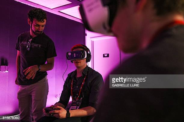 Chad Johnson of OmgChad gets help from Jared Greiner during a press demonstration of Minecraft for Gear VR at The Village event space in San...