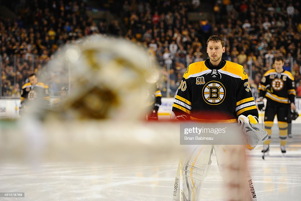 Chad Johnson #30 of the Boston Bruins stands on the ice during the National Anthem prior to the game against the Carolina Hurricanes at the TD Garden on November 23, 2013 in Boston, Massachusetts.
