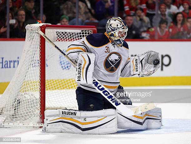 Chad Johnson of the Buffalo Sabres makes a glove save against the Chicago Blackhawks at the United Center on January 8 2016 in Chicago Illinois The...