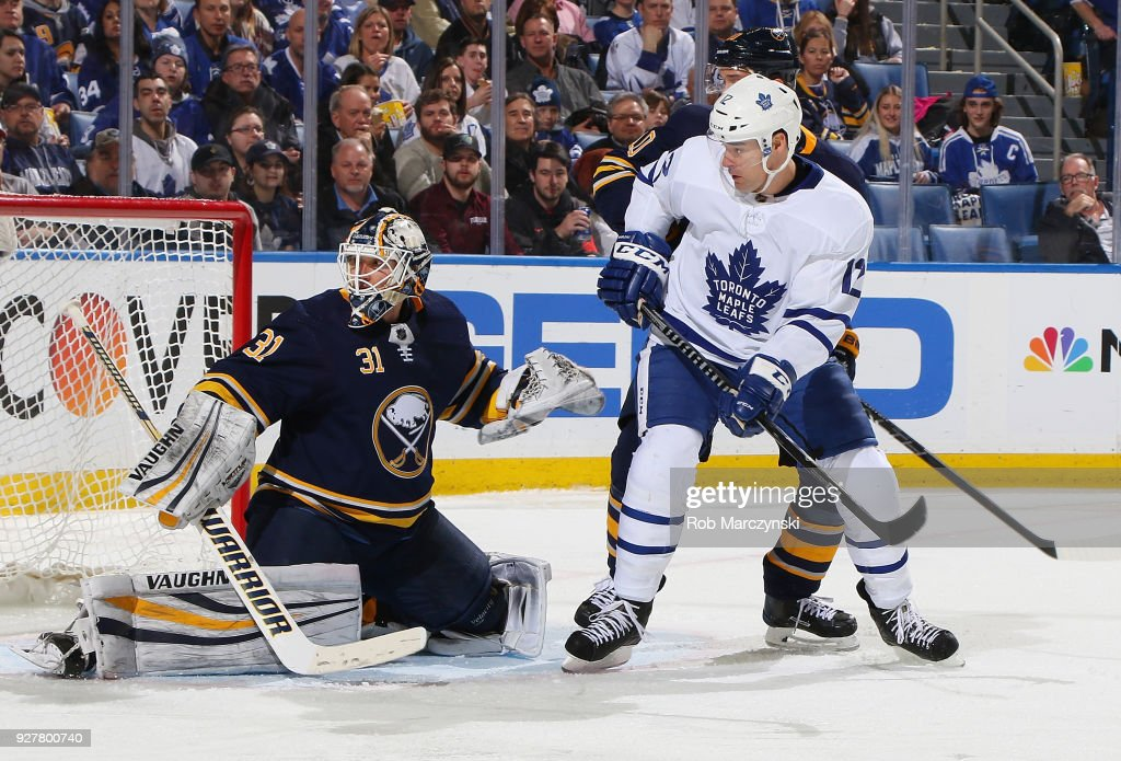 Chad Johnson #31 of the Buffalo Sabres makes a save in front of Patrick Marleau #12 of the Toronto Maple Leafs during an NHL game on March 5, 2018 at KeyBank Center in Buffalo, New York. Buffalo won, 5-3.