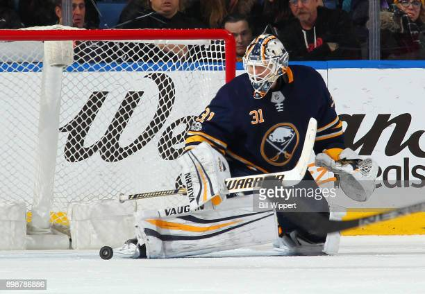 Chad Johnson of the Buffalo Sabres tends goal during an NHL game against the Carolina Hurricanes on December 15 2017 at KeyBank Center in Buffalo New...