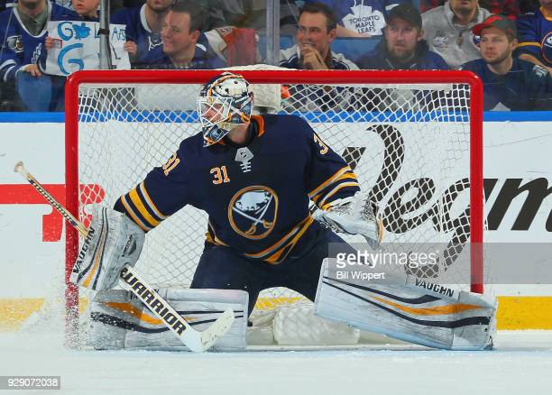 Chad Johnson of the Buffalo Sabres tends goal during an NHL game against the Toronto Maple Leafs on March 5 2018 at KeyBank Center in Buffalo New...