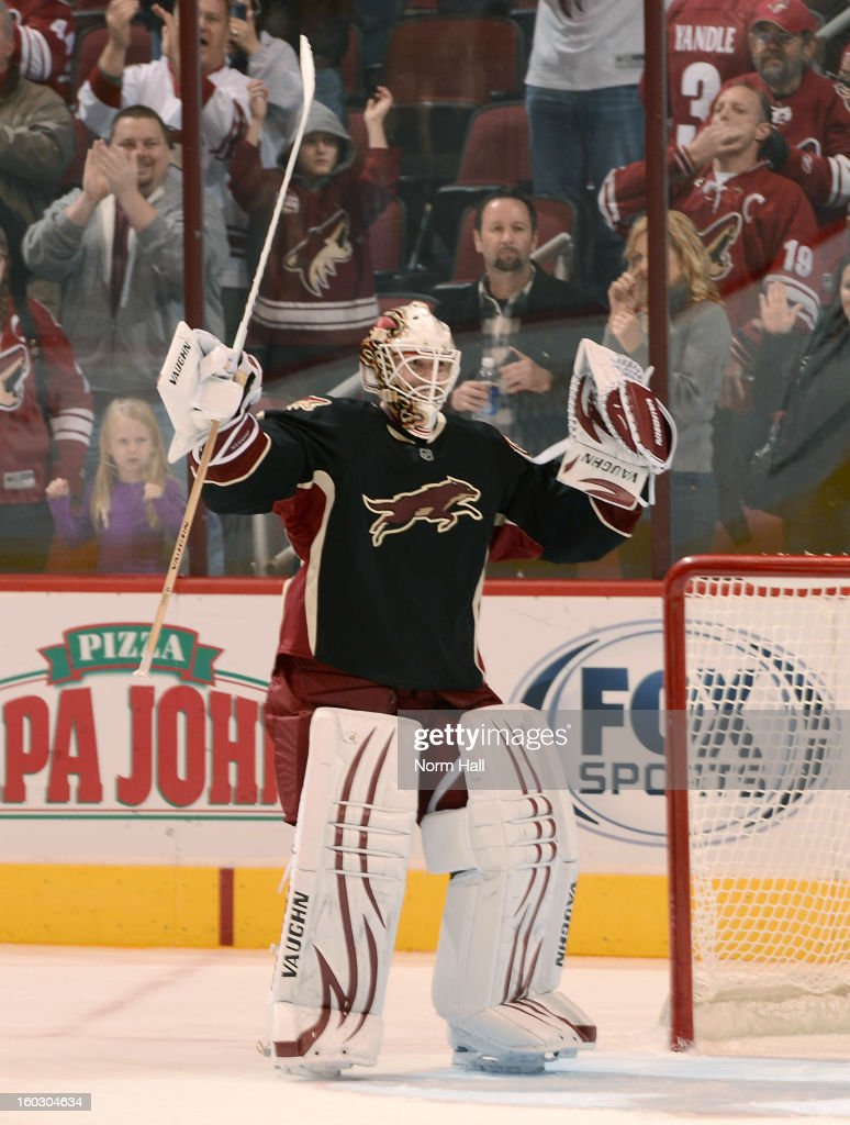 Chad Johnson #31 of the Phoenix Coyotes celebrates his 4-0 shut out of the Nashville Predators at Jobing.com Arena on January 28, 2013 in Glendale, Arizona. It was Johnson's first career shut-out.