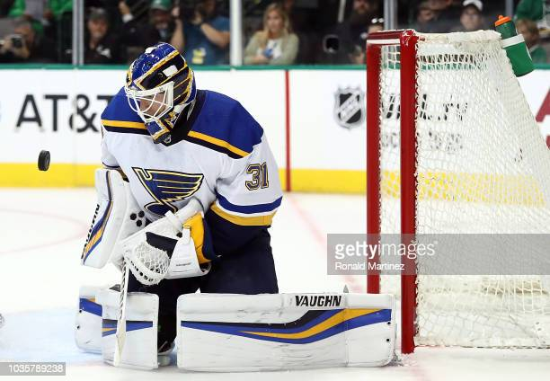 Chad Johnson of the St Louis Blues makes a save against the Dallas Stars in the first period during a preseason game at American Airlines Center on...