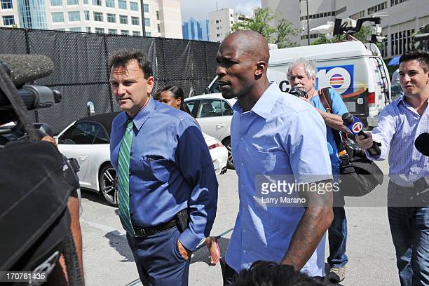 Chad Johnson walks with his sports agent Drew Rosenhaus after being released from the Broward County Jail on June 17, 2013 in Fort Lauderdale,...