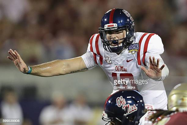 Chad Kelly of the Mississippi Rebels communicates at the line of scrimmage in the first half against the Florida State Seminoles during the Camping...
