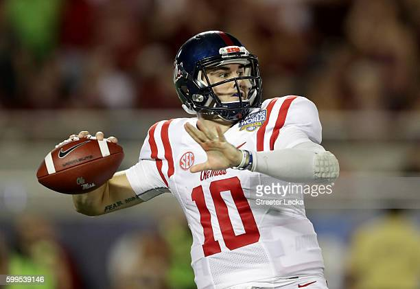 Chad Kelly of the Mississippi Rebels drops back to pass against the Florida State Seminoles uring the Camping World Kickoff at Camping World Stadium...