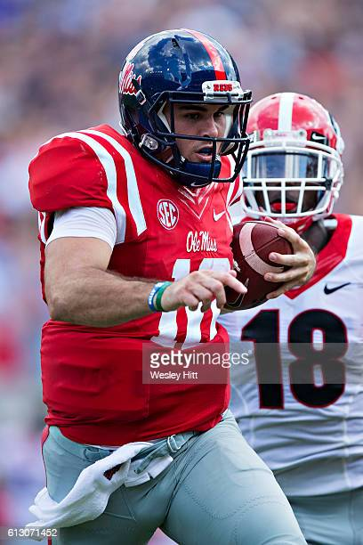 Chad Kelly of the Mississippi Rebels runs the ball and is chased down from behind by Deandre Baker of the Georgia Bulldogs at VaughtHemingway Stadium...