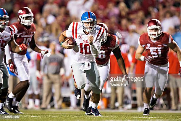 Chad Kelly of the Mississippi Rebels runs the ball for a touchdown during a game against the Arkansas Razorbacks at Razorback Stadium on October 15...