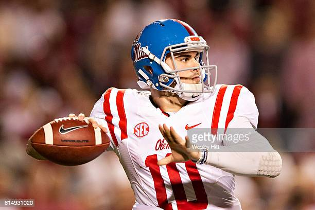 Chad Kelly of the Mississippi Rebels throws a pass during a game against the Arkansas Razorbacks at Razorback Stadium on October 15 2016 in...