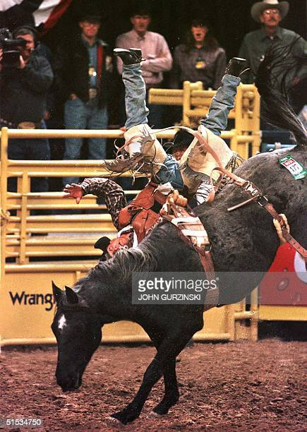 Chad Klein of Jackson LA goes heels over head as he is tossed from the back of bucking bronco Khadafy Skoal in the bareback riding event at the 5th...
