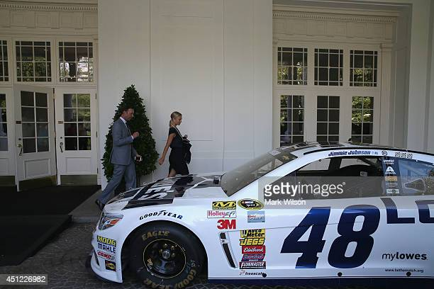 Chad Knaus and Brooke Werner walk out of the White House after 2013 NASCAR Sprint Cup Series Champion Jimmie Johnson was honored in the East Roomon...