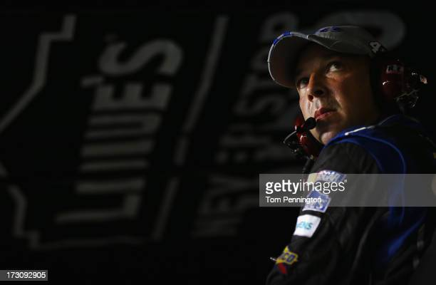 Chad Knaus crew chief for Jimmie Johnson driver of the Lowe's Dover White Chevrolet looks on during the NASCAR Sprint Cup Series Coke Zero 400 at...