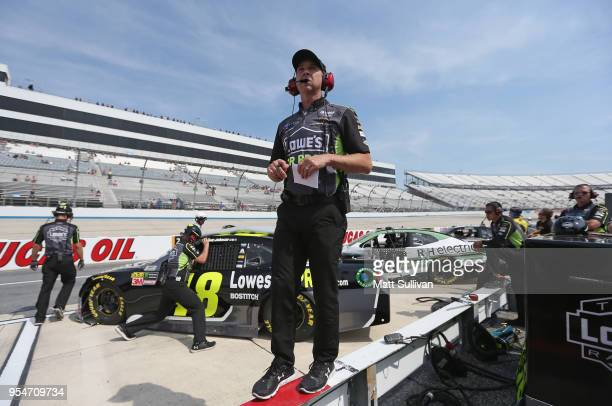 Chad Knaus crew chief for Jimmie Johnson driver of the Lowe's for Pros Chevrolet watches qualifying for the Monster Energy NASCAR Cup Series AAA 400...
