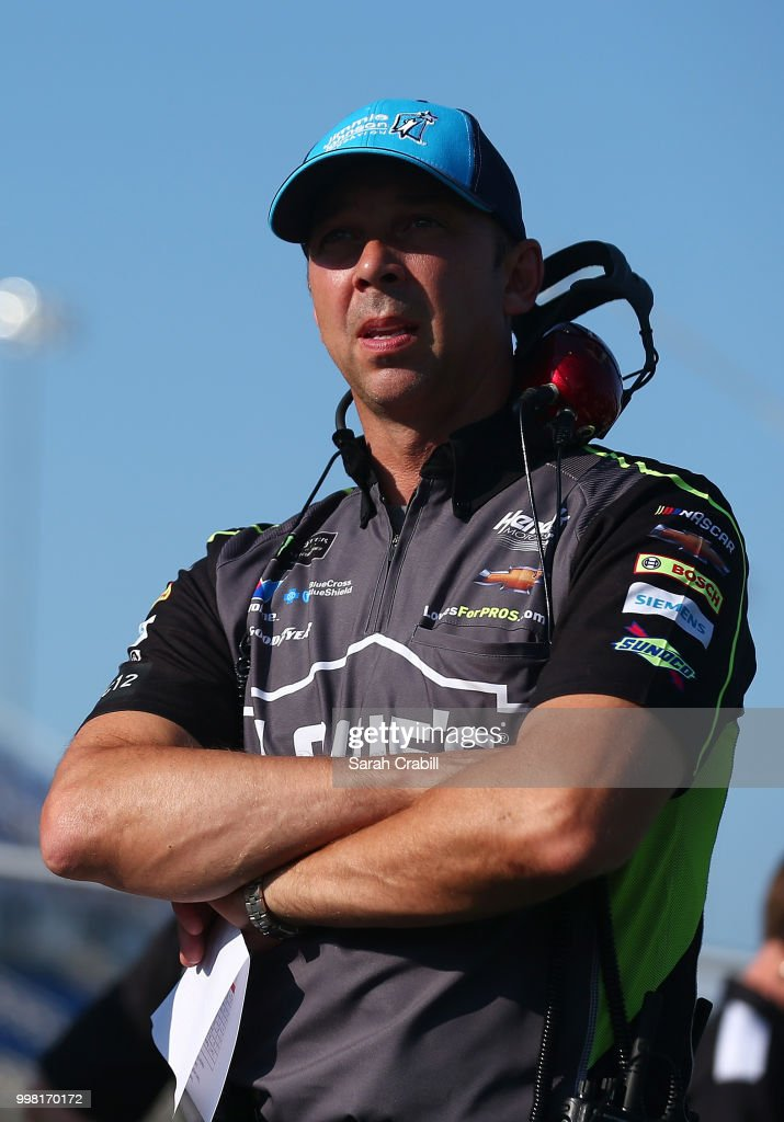 Chad Knaus, crew chief for Jimmie Johnson, driver of the #48 Lowe's/Jimmie Johnson Foundation Chevrolet, stands on the grid during qualifying for the Monster Energy NASCAR Cup Series Quaker State 400 presented by Walmart at Kentucky Speedway on July 13, 2018 in Sparta, Kentucky.