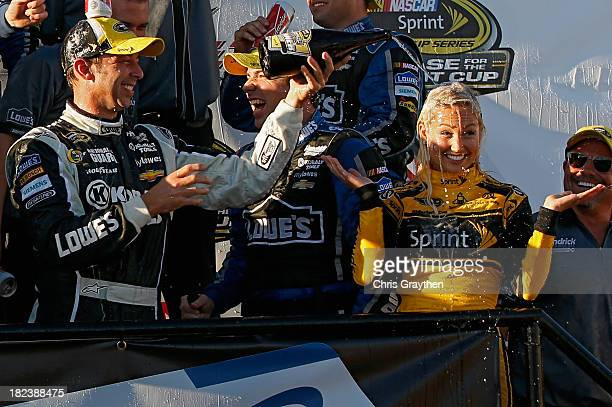 Chad Knaus crew chief of the Lowe's / Kobalt Tools Chevrolet douses Miss Sprint Brooke Werner with champagne in Victory Lane after winning the NASCAR...