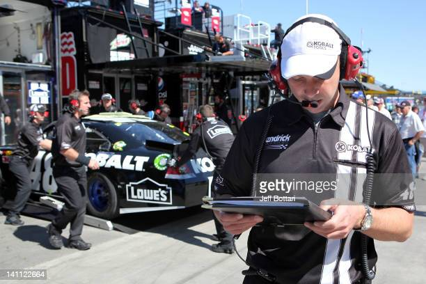 Chad Knaus crew chief of the Lowe's/Kobalt Tools Chevrolet driven by Jimmie Johnson helps prepare a backup car after Johnson crashed during practice...