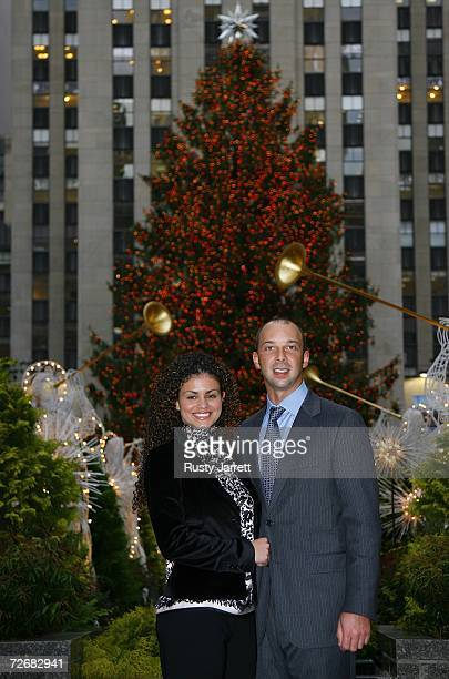 Chad Knaus the 2006 NASCAR Nextel Cup Series Champion crew chief stands with his girlfriend Burna Oliviera in Rockefeller Center on November 30 2006...