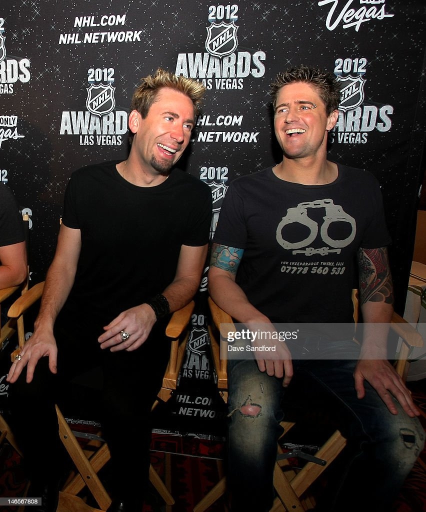 Chad Kroeger (left) and Daniel Adair of the band Nickelback share a laugh during the 2012 NHL Awards Nominee Media Availability at the Wynn Las Vegas Resort on June 19, 2012 in Las Vegas, Nevada.