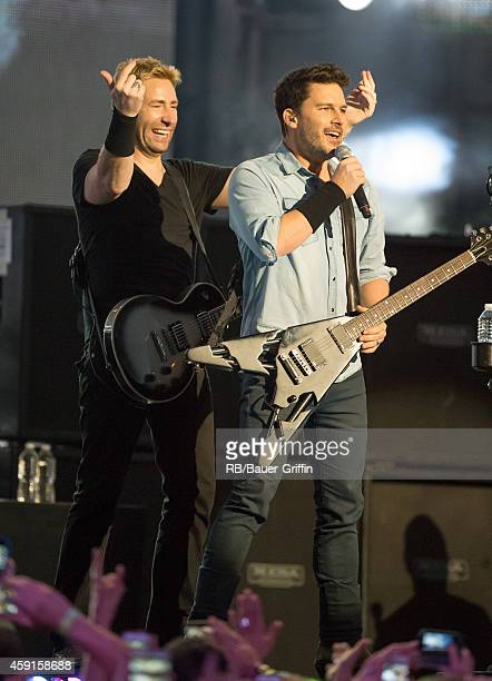 Chad Kroeger and Ryan Peake of the band 'Nickelback' is seen at 'Jimmy Kimmel Live' on November 17 2014 in Los Angeles California