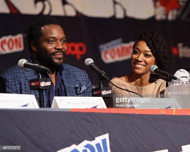 Chad L Coleman and Sonequa MartinGreen speak at The Walking Dead NY Comic Con Panel on October 11 2014 in New York City