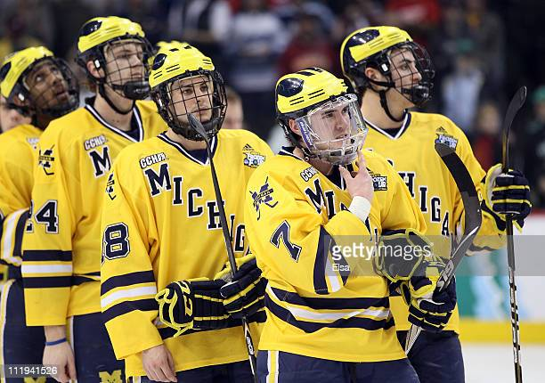 Chad Langlais of the Michigan Wolverines waits to shake hands with the Minnesota Duluth Bulldogs after the championship game of the 2011 NCAA Men's...