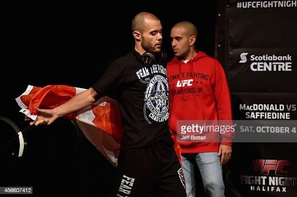 Chad Laprise of Canada walks onstage with the Canadian flag during the UFC Fight Night weighin at the Scotiabank Centre on October 3 2014 in Halifax...