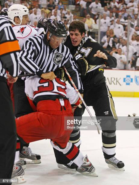 Chad LaRose of the Carolina Hurricanes and Evgeni Malkin of the Pittsburgh Penguins battle in the closing minutes during Game Two of the Eastern...