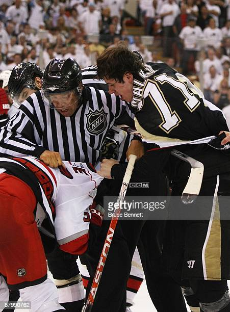 Chad LaRose of the Carolina Hurricanes and Evgeni Malkin of the Pittsburgh Penguins battle during Game Two of the Eastern Conference Championship...