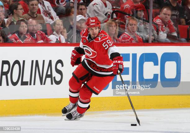 Chad LaRose of the Carolina Hurricanes attempts to control a loose puck against the Tampa Bay Lightning during a NHL game on October 7 2011 at RBC...