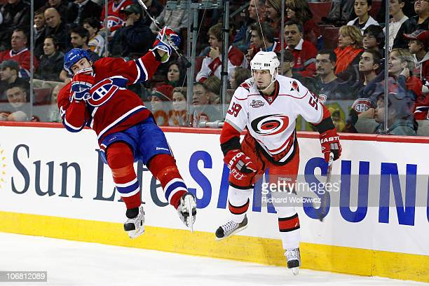 Chad LaRose of the Carolina Hurricanes body checks Roman Hamrlik of the Montreal Canadiens during the NHL game at the Bell Centre on November 13 2010...