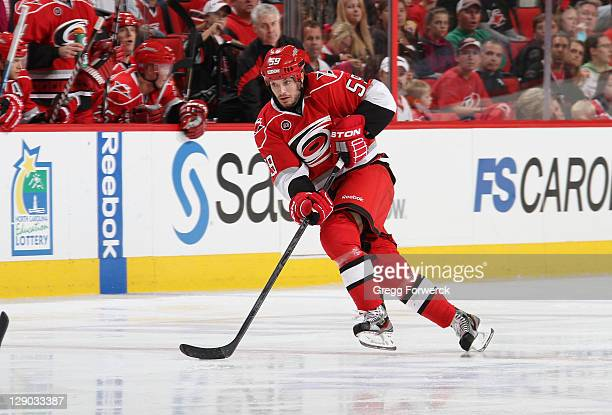 Chad LaRose of the Carolina Hurricanes carries the puck against the Tampa Bay Lightning during a NHL game on October 7 2011 at RBC Center in Raleigh...
