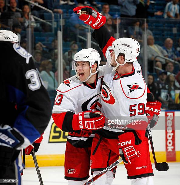 Chad LaRose of the Carolina Hurricanes celebrates his goal with teammate Ray Whitney who assisted against the Tampa Bay Lightning at the St Pete...