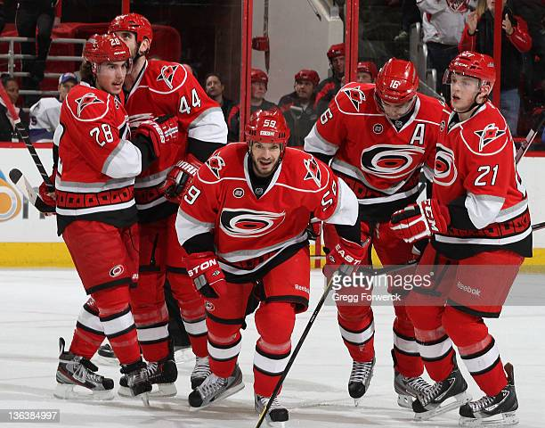 Chad LaRose of the Carolina Hurricanes celebrates his third period goal to go ahead during an NHL game against the New York Islanders on January 3...
