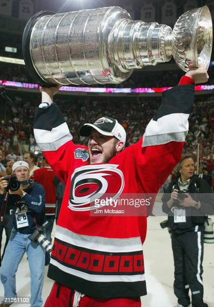 Chad LaRose of the Carolina Hurricanes celebrates with the Stanley Cup after defeating the Edmonton Oilers in game seven of the 2006 NHL Stanley Cup...