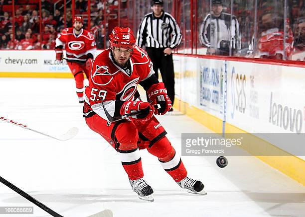 Chad LaRose of the Carolina Hurricanes chases a loose puck against the Washington Capitals during their NHL game at PNC Arena on April 2 2013 in...