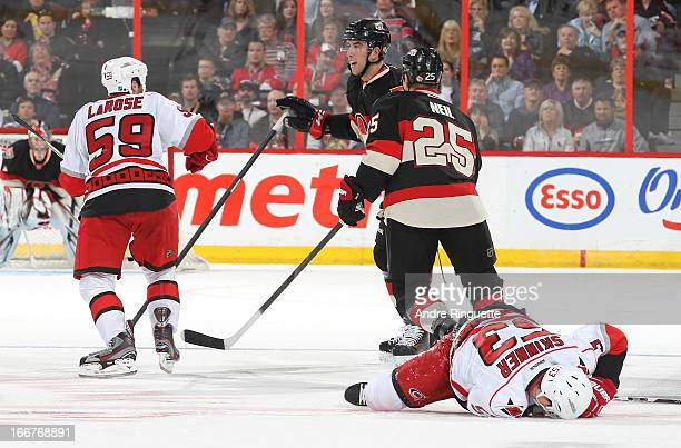 Chad LaRose of the Carolina Hurricanes chases Jared Cowen of the Ottawa Senators to instigate a fight after his hit on Jeff Skinner of the Ottawa...