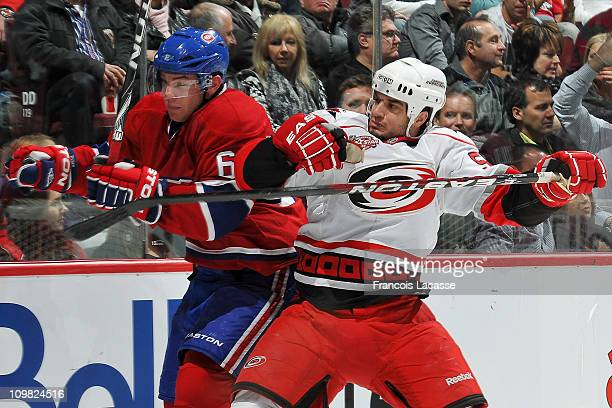 Chad LaRose of the Carolina Hurricanes checks Yannick Weber of the Montreal Canadiens into the boards during the NHL game on February 26 2011 at the...