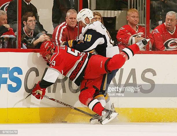 Chad LaRose of the Carolina Hurricanes collides into Tim Connolly of the Buffalo Sabres during their NHL game on March 21 2010 at the RBC Center in...